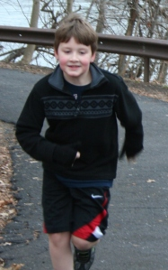 Bryce running up a hill at his first 5k in DEC 2011.