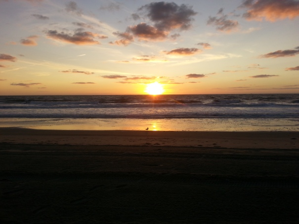 What is it about the Sun Rising over the ocean?